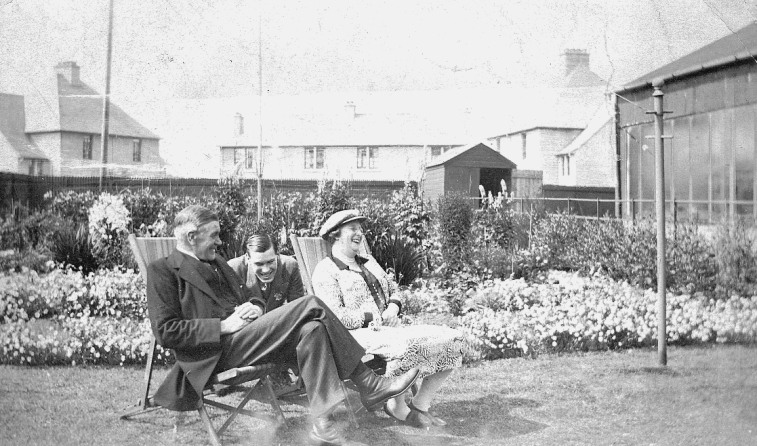 Robert Anderson, his wife Elizabeth and son John in the garden of their home Craigard.